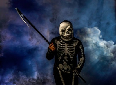 Image of a trick-or-treater wearing a Grim Reaper costume